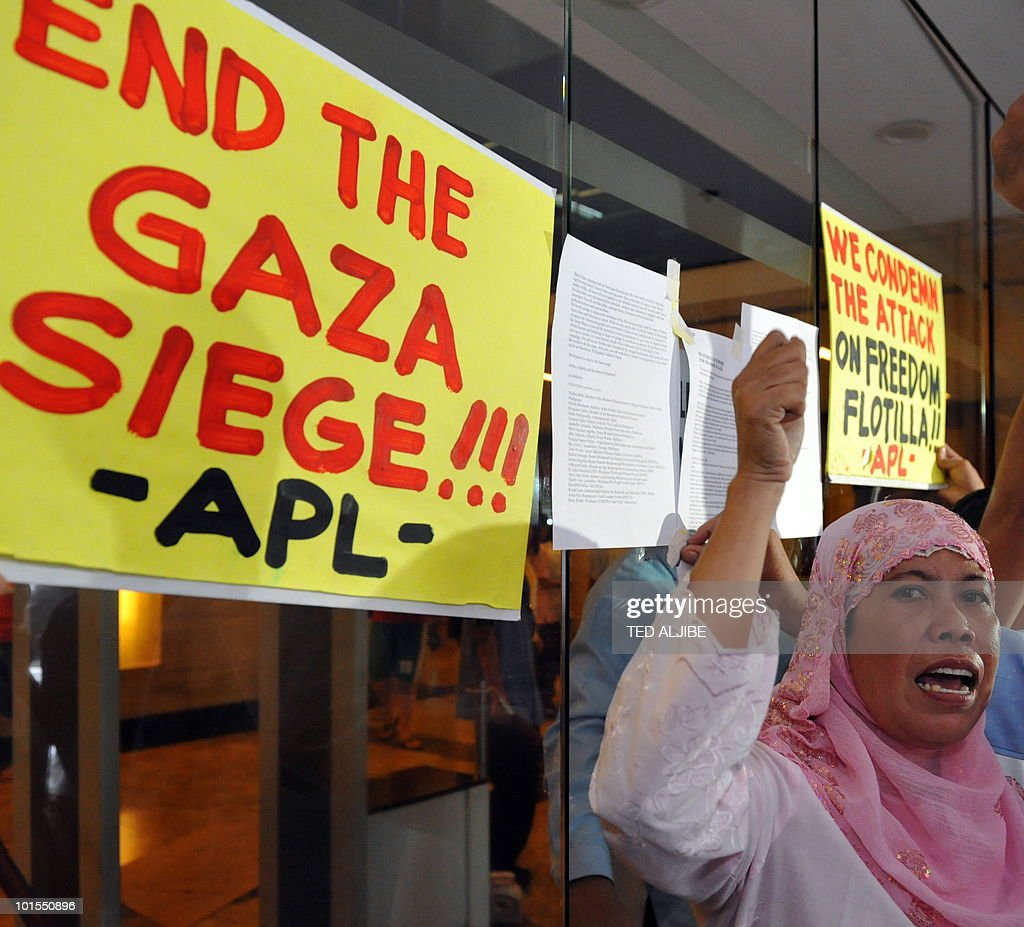 A protester shouts anti-Israeli slogans during a pro-Palestinian protest condemning the Israeli military action against the aid flotilla outside the building housing Israeli embassy in the financial district of Manila on June 2, 2010. Activists in the Philippines on June 2, strongly condemned what they called a brutal attack by Israel on a Gaza-bound aid flotilla that left nine people dead.
