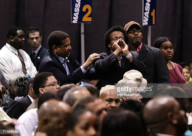 A protester shouts as US President George W Bush speaks to the national convention of the National Association for the Advancement of Colored People...