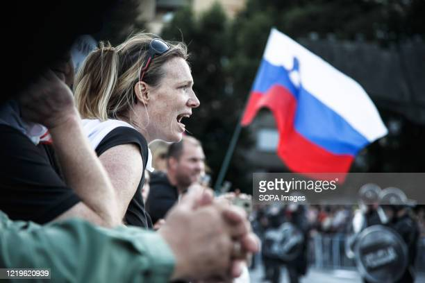 Protester shouts at the police during an anti-government protest. Every Friday, thousands of people in Ljubljana protest against the government of...