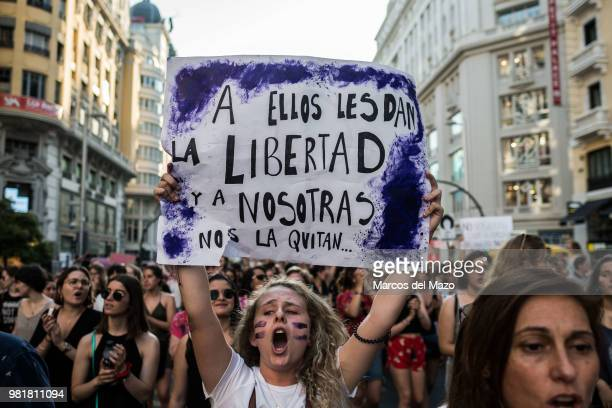 """Protester shouts carrying a placard that reads """"They give them freedom and they take it from us"""", during a protest against court's decision to..."""