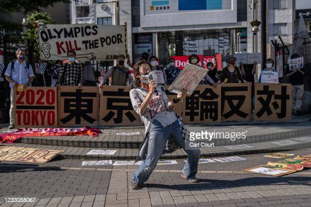 Protester shouts into a microphone during a demonstration against the forthcoming Tokyo Olympic Games on May 23, 2021 in Tokyo, Japan. IOC vice...