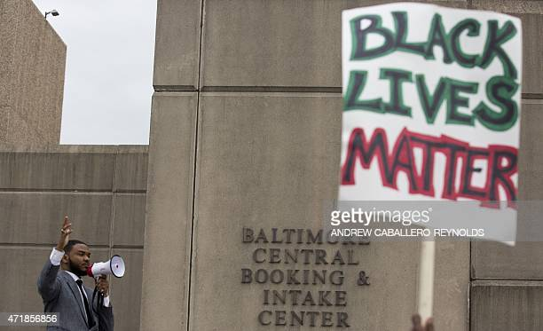 Protester shouts outside the Baltimore Police Central Booking and Intake Center for prisoners in Baltimore, Maryland on May 1, 2015. Six Baltimore...