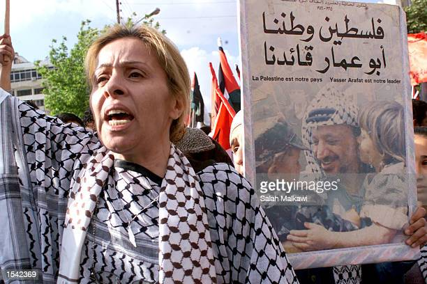 A protester shouts proPalestinian slogans in support of Palestinian President Yasser Arafat while at a rally May 15 2002 in Amman Jordan...