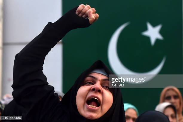 A protester shouts slogans against the United States during a demonstration following a US airstrike that killed top Iranian commander Qasem...