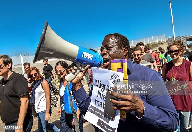 A protester shouts slogans as people march in the northern French port of Calais on August 8 2015 during a rally in support of migrants and in memory...