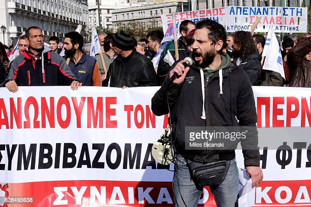 A protester shouts slogans as thousands of people take part in a demonstration on December 8 2016 in Athens Greece A nationwide 24hour general strike...