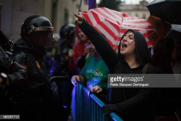 A protester shouts slogans next to a police cordon near Oriente Square during a demonstration against the Spanish Monarchy under the header 'Check...