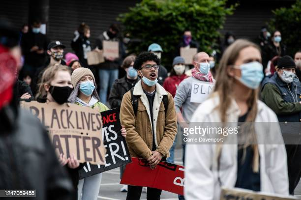 Protester shouts the names of those killed by racist volence during a Socially distanced demonstration taking place at Custom House Square, in...