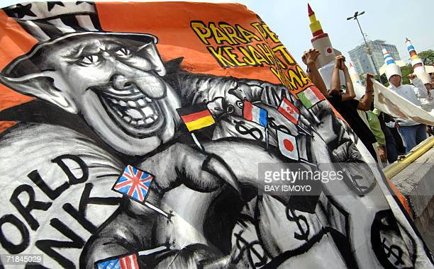 Protester show a banner that illustrate US imperialism in the poor countries during an antiUS IMF and World Bank protest in front of the US embassy...