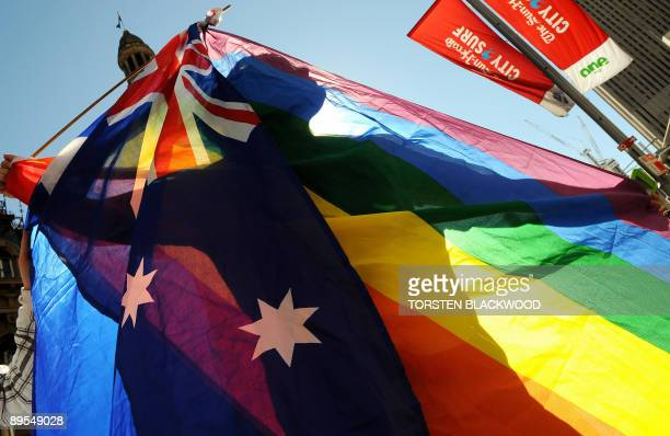 A protester shows his colours during a gay rights march through Sydney to the ruling Labor Party's conference to stage a mass 'illegal wedding' stunt...