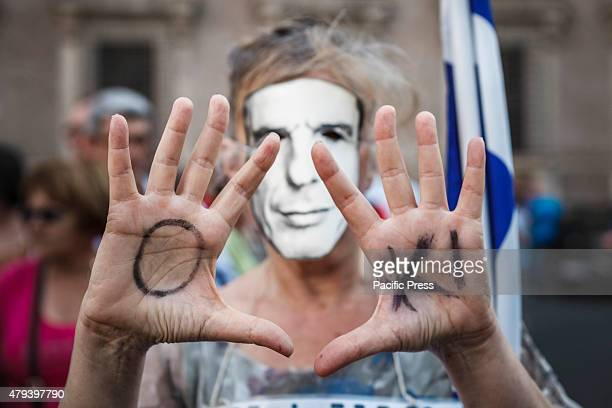 A protester shows the word 'Oki' on her hands as she takes part in a rally to support No vote at the upcoming Greek referendum on European Union...