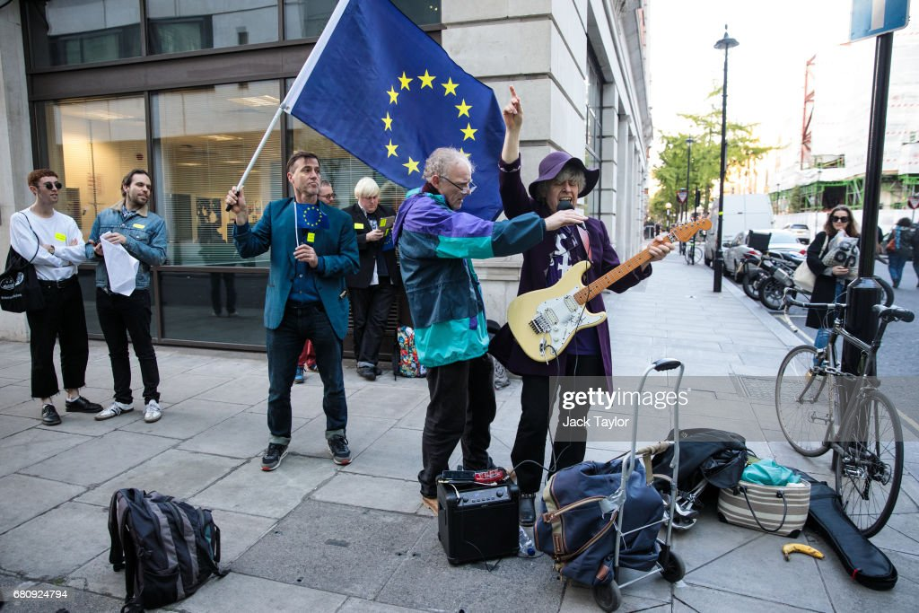 A protester sings and plays guitar during a demonstration outside BBC's Broadcasting House as British Prime Minister Theresa May and her husband Philip May give a joint interview on the One Show on May 9, 2017 in London, England. Campaigning is underway ahead of the June 8th general election.