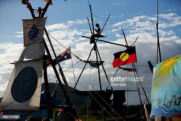 A protester sits at the Bentley blockade site on May 15 2014 in Lismore Australia Antigas protesters are celebrating today after a drilling permit...