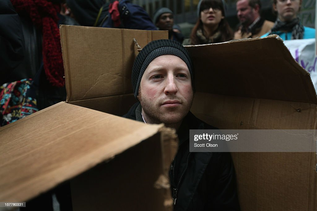 A protester sits in a shanty constructed of cardboard in the Federal Building Plaza on December 6, 2012 in Chicago, Illinois. Protesters built the shantytown, which they dubbed 'Durbinville' after U.S. Senator Dick Durbin (D-IL), to persuade Durbin to push for an increase of taxes on the wealthy and oppose cuts in Social Security, Medicare, and Medicaid