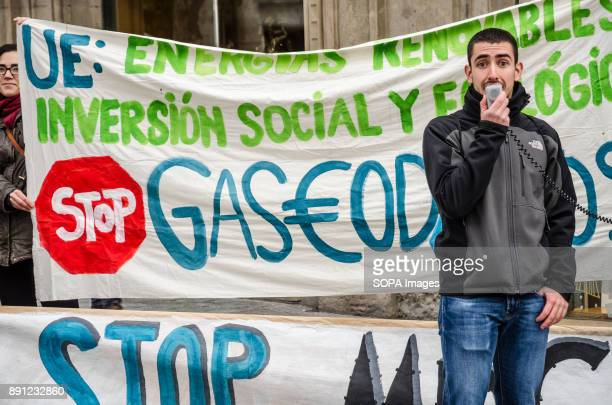 A protester speaking by megaphone in front of a large banner against the new projects for gas pipelines in Europe and Africa Coinciding with the...