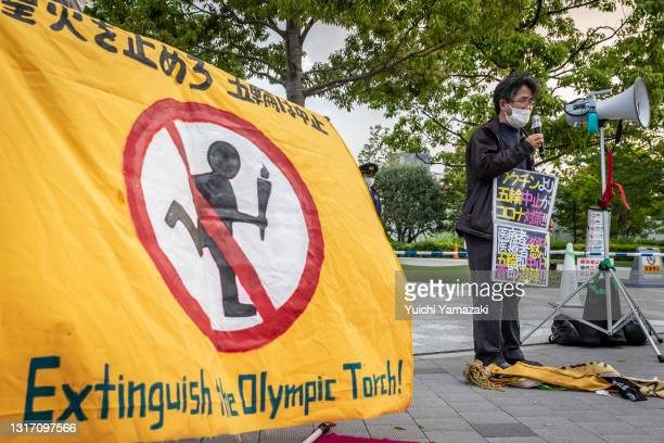 Protester speaks during a protest against the Tokyo Olympics on May 09, 2021 in Tokyo, Japan. With less than 3 months remaining until the Tokyo 2020...