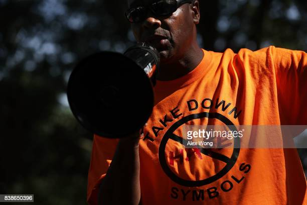 A protester speaks during a rally calling for the removal of a Confederate soldier statue on the grounds of the City of Virginia Beach Municipal...