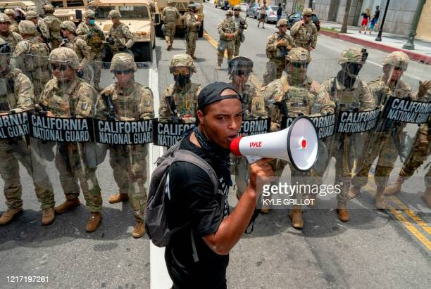 TOPSHOT A protester speaks in front of the California National Guard during a demonstration over the death of George Floyd while in Minneapolis...
