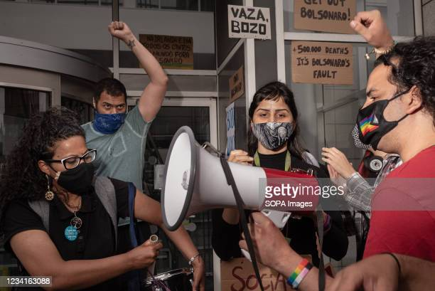 Protester speaks on a megaphone during the demonstration. In Dublin, Ireland, another day of protests against the Brazilian President Jair Bolsonaro...