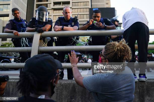 Protester speaks to police officers during a demonstration on May 31, 2020 in Atlanta, Georgia. Across the country, protests have erupted following...