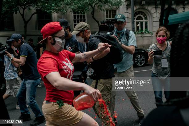 Protester spills red paint on the street during a march against police brutality on June 11, 2020 in New York City. Demonstrations against systemic...