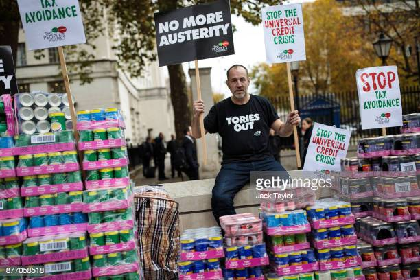 A protester stages a food bank demonstration on Whitehall complete with tons of packaged food against the Government's Universal Credit programme on...