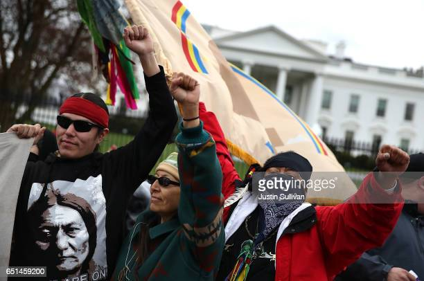 A protester stand in front of the White House during a demonstration against the Dakota Access Pipeline on March 10 2017 in Washington DC Thousands...