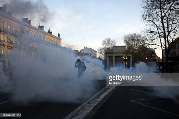 A protester stands amid clouds of tear gas Act XIII dubbed 'Civil disobediencequot' of the Yellow Vest movement begun peacefully but the protest...