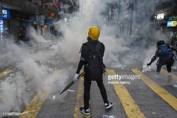 Protester stands defiant despite tear gas smoke surrounds him as thousands of anti-china protesters marched and clashed with police in Hong Kong as...