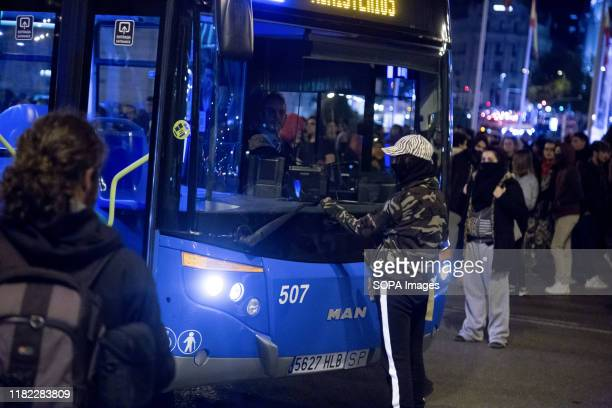 Protester stands in front of a bus during the demonstration. The municipal police evicted without prior notice the self-managed community centre La...