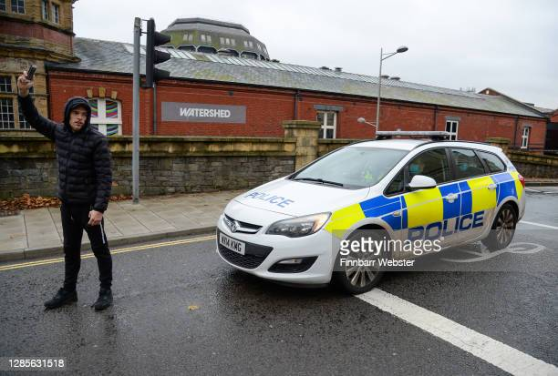 Protester stands in front of a police car during the anti-lockdown protest on November 14, 2020 in Bristol, England. Police had warned protesters to...
