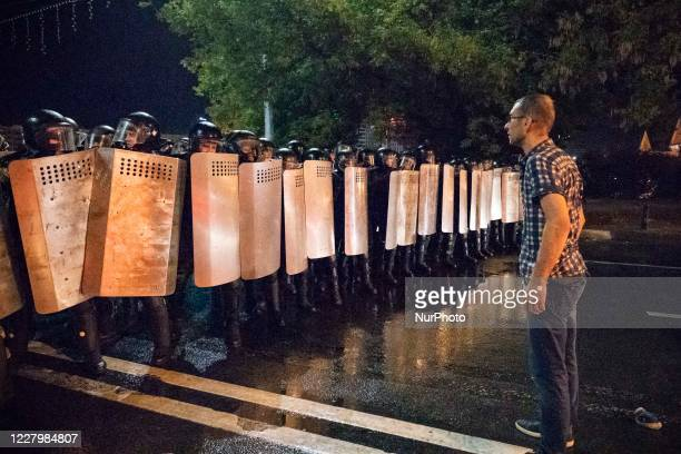 Protester stands in front of the riot police in a public unrest started in the streets of Minsk, Belarus, on August 9, 2020 at the end of the voting...