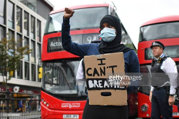Protester stands in the road blocking the traffic as people gather in Westbourne Park to take part in the inaugural Million People March march from...
