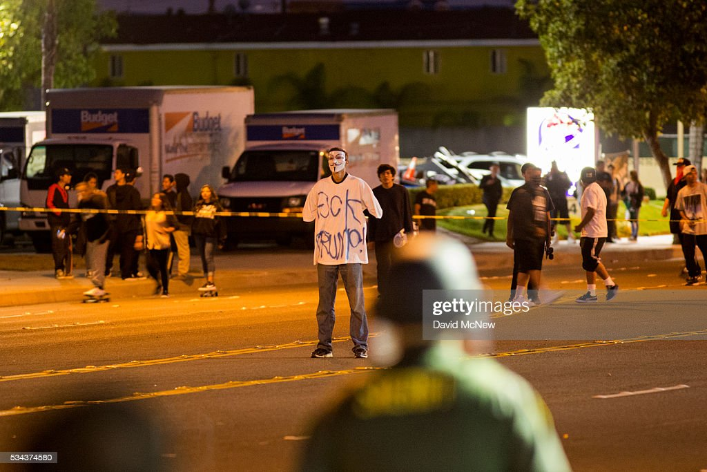 A protester stands in the street as police advance to make possible mass arrests after declaring an unlawful assembly following a campaign rally by presumptive GOP presidential candidate Donald Trump at the Anaheim Convention Center earlier in the day on May 25, 2016 in Anaheim, California. Previous visits by the candidate to Orange County have sparked protests that resulted in some arrests. The presidential candidates are campaigning in Southern California for the June 7 California primary.
