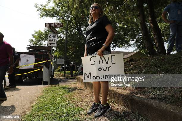 A protester stands next to a Confederate monument in Fort Sanders in advance of a planned white supremacist rally and counterprotest around the...