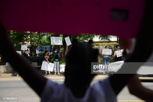 Protester stands on the side of Hot Springs, Arkansas' main street during an anti-police brutality protest, Monday, 1 June 2020.