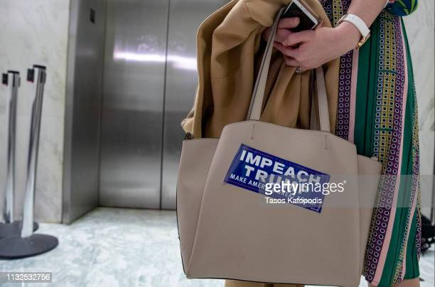 Protester stands outside the hearing where Michael Cohen, former attorney and fixer for President Donald Trump is testifying before the House...