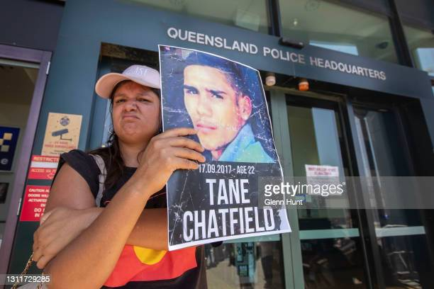 Protester stands outside the Queensland Police Headquarters on April 10, 2021 in Brisbane, Australia. The national day of action marks 30 years since...