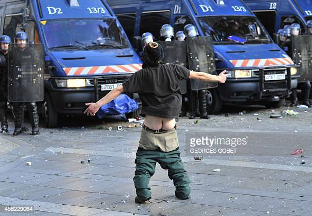 A protester stands with his pants pulled down in front of riot police during clashes on November 1 2014 Nantes western France during a demonstration...