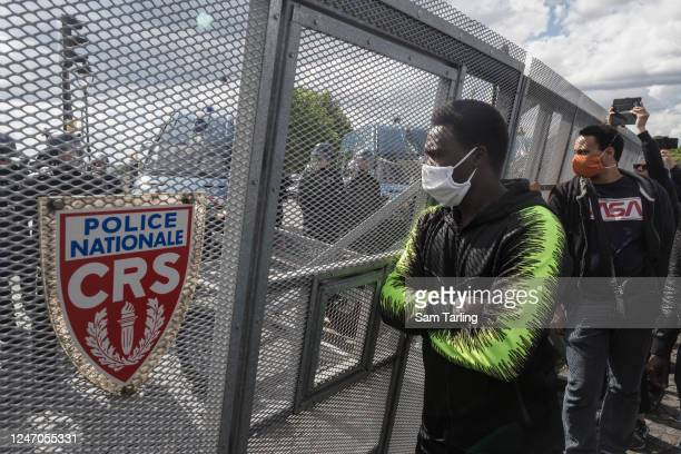 Protester stares at riot police during a demonstration against racism and police brutality in Place de La Concorde near the US embassy on June 6,...