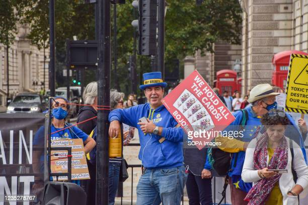 Protester Steve Bray, also known as 'Mr Stop Brexit' holds a placard which says 'We Hold All The Cards' during the demonstration. Protesters gathered...