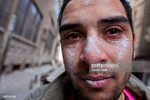 A protester suffers from the effects of tear gas inhalation during clashes between protesters and riot police near the interior ministry February 3...