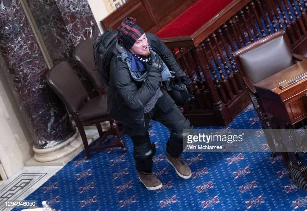Protester supporting U.S. President Donald Trump moves to the floor of the Senate chamber at the U.S. Capitol Building on January 06, 2021 in...