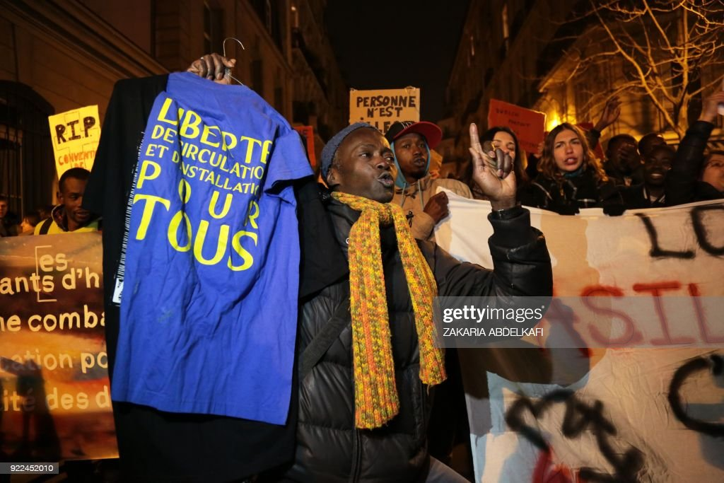 Protester take part in a demonstration against the French government's new immigration bill in Paris on February 21, 2018. The French government defended a new immigration bill as 'completely balan...