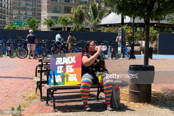 Protester takes a break during the Queer March for Black Lives on June 28, 2020 in New York City. The LGBTQ+ community celebrates the 51st...