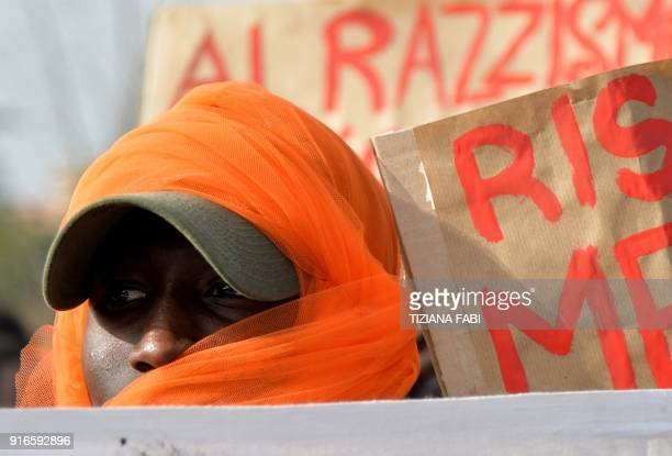 A protester takes part in an antiracism demonstration in the central Italian town of Macerata on February 10 one week after an attack that injured at...