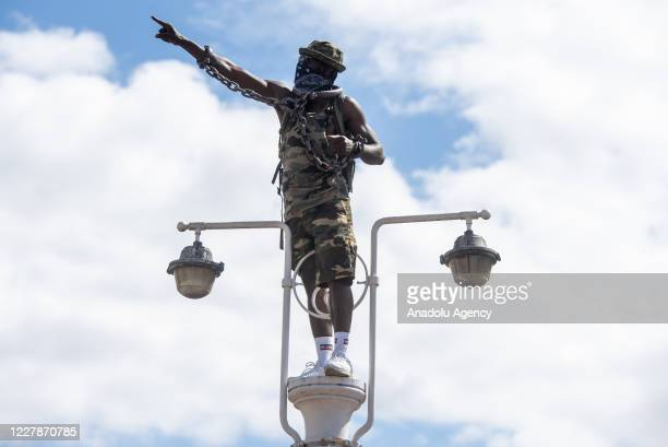 August 01: A protester takes part in supporting Reparations March UK & Afrikan Emancipation Dayreclaim Brixton town centre in order to promote...