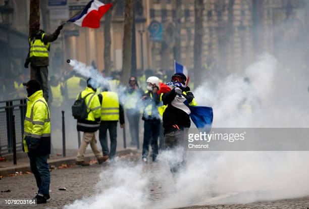 A protester takes part in the demonstration of the yellow vests on the Friedland avenue on December 08 2018 in Paris France The Yellow Vest protests...