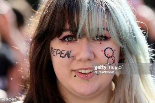 A protester takes part in the March for Choice calling for the legalising of abortion in Ireland after the referendum announcement in Dublin on...