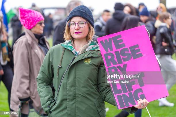 A protester takes the high road in her 'we rise by lifting' sign at Portland's National March for Impeachment on January 20 in downtown Portland OR